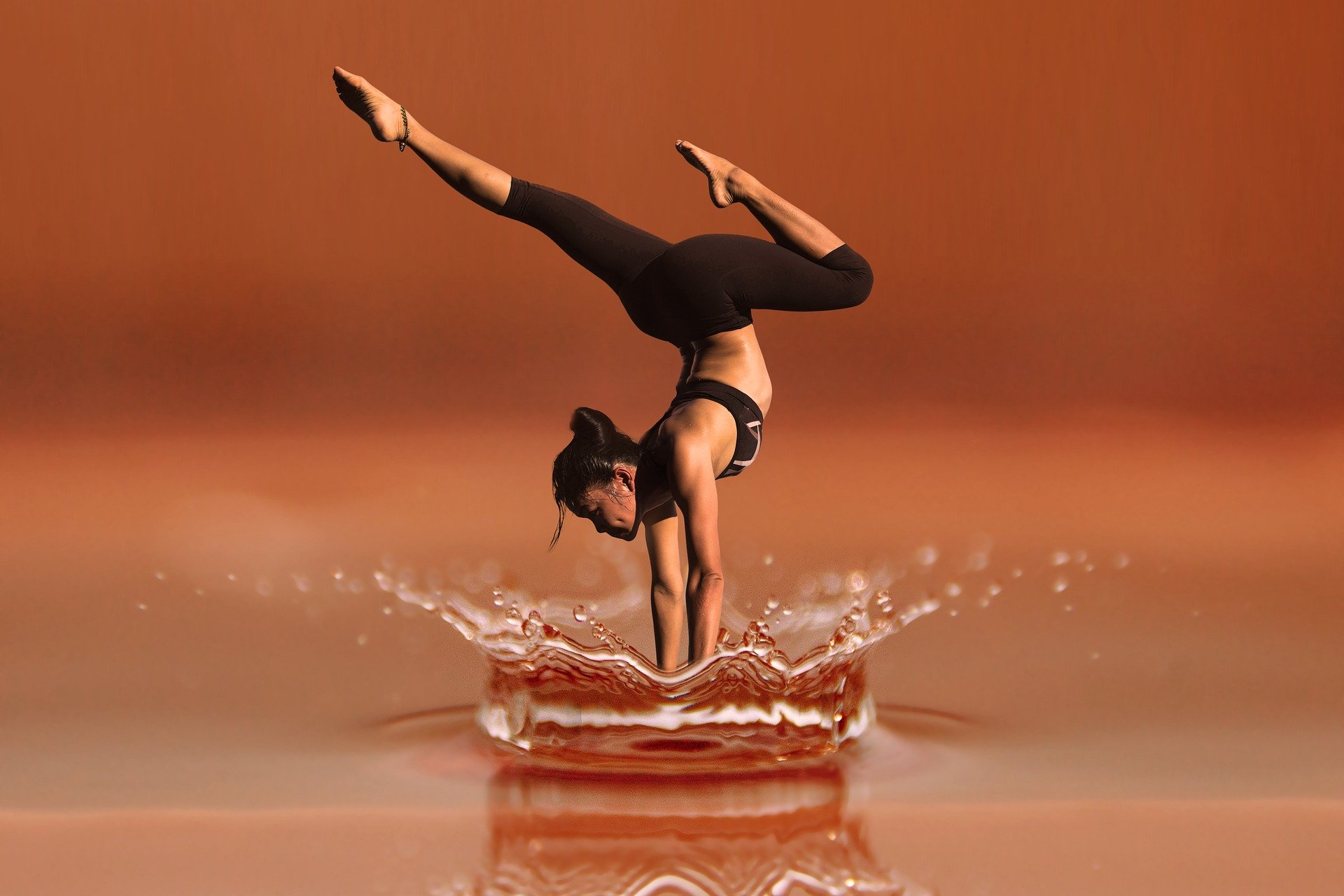 women doing yoga on the water and dancing